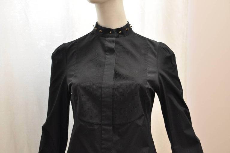Beautiful quality cotton with a studded mandarin collar and piquet bib. There is concealed button fastening at the front with a stud collar closure. The cuffs are pleated and use a stud instead of a button. This is a slim fit shirt. Made in Italy.