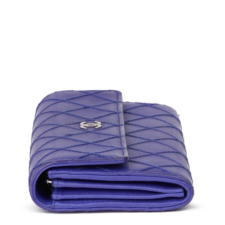 CHANEL Electric Blue Quilted Lambskin Wallet   Xupes Reference: HB3276 Serial Number: 19301605 Age (Circa): 2014 Accompanied By: Chanel Dust Bag  Authenticity Details: Serial Sticker (Made in Italy)  Gender: Ladies Type: Accessory  Colour: Blue