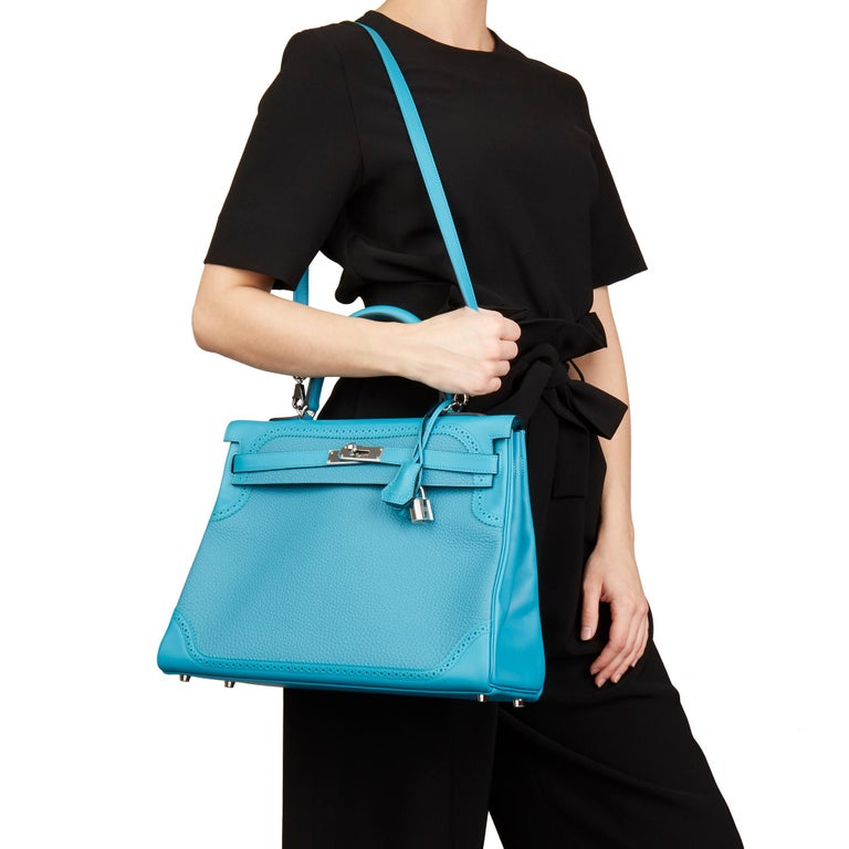 HERMÈS Turquoise Togo & Swift Leather Ghillies Kelly 35cm Retourne  Xupes Reference: HB2529 Serial Number: [R] Age (Circa): 2014 Accompanied By: Hermès Dust Bag, Box, Lock, Keys, Clochette, Rain Cover, Protective Felt, Shoulder Strap, Care