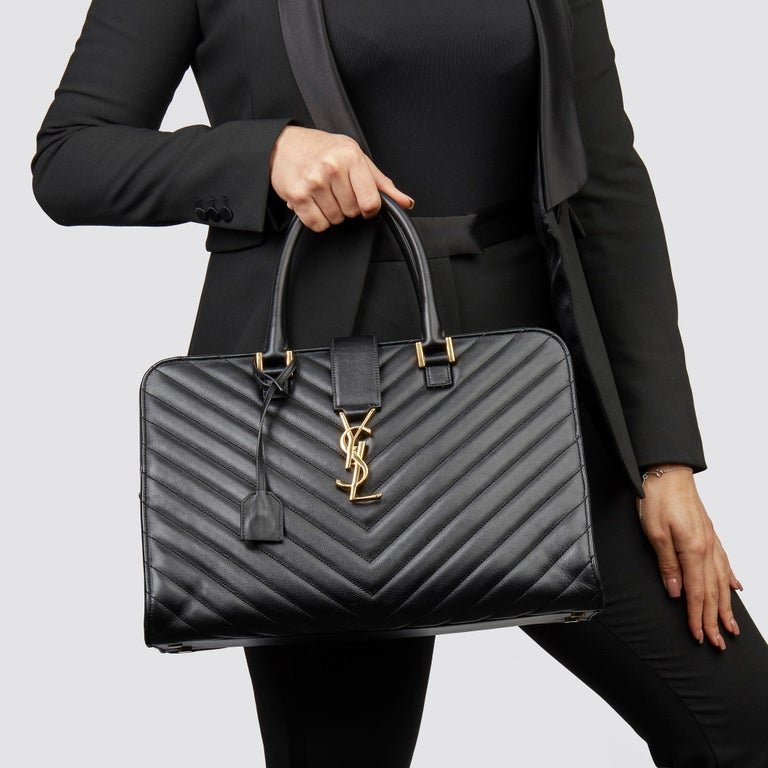 SAINT LAURENT Black Quilted Large Chevron Tote Bag   Xupes Reference: CB234 Serial Number: DPL357396.0614 Age (Circa): 2014 Accompanied By: Saint Laurent Dust Bag, Clochette, Shoulder Strap  Authenticity Details: Serial Sticker (Made in