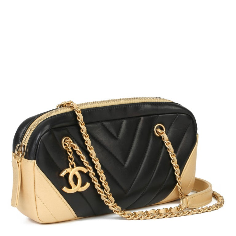 CHANEL Black & Gold Chevron Quilted Lambskin Timeless Charm Camera Bag  Xupes Reference: HB3951 Serial Number: 20874811 Age (Circa): 2015 Accompanied By: Chanel Dust Bag, Box, Authenticity Card, Care Booklet Authenticity Details: Authenticity Card,