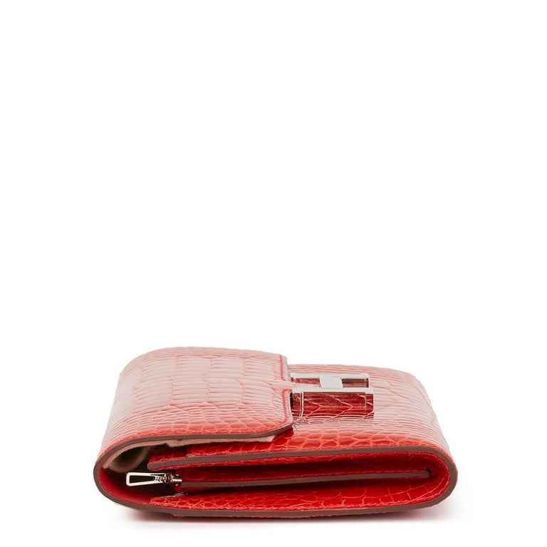 HERMÈS Geranium Shiny Mississippiensis Alligator Leather Constance Long Wallet   Reference: HB1829 Serial Number: T Age (Circa): 2015 Accompanied By: Hermès Dust Bag, Protective Felt Authenticity Details: Date Stamp (Made in France) Gender: