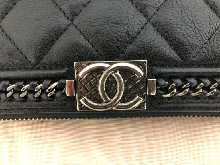 It is a zip around limited edition 2016-17 long wallet/clutch in as new condition, made in France. The limited edition relates to the chain trim embellishment. The pattern caviar leather is distressed and there is a CC, I believe ruthenium quilted