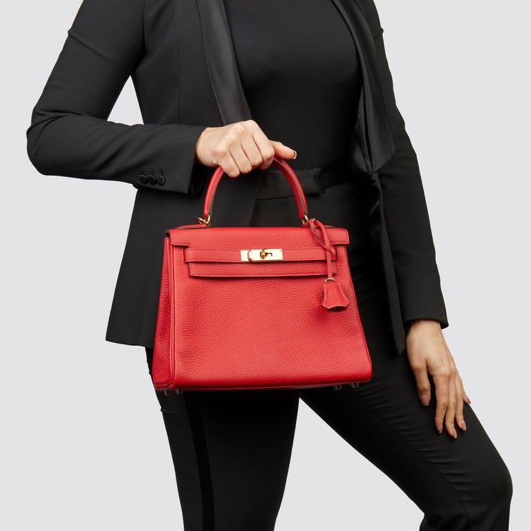 HERMÈS Rouge Casaque Clemence Leather Kelly 28cm Retourne  Xupes Reference: CB233 Serial Number: X Age (Circa): 2016 Accompanied By: Hermès Dust Bag, Box, Padlock, Keys, Clochette, Protective Felt, Strap, Rain Cover, Care Booklet  Authenticity