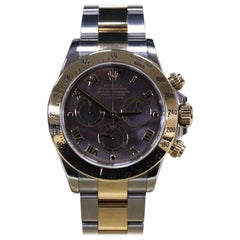 2016 Rolex Daytona 116523 18 Karat Gold and Stainless Black Mother-of-Pearl Dial