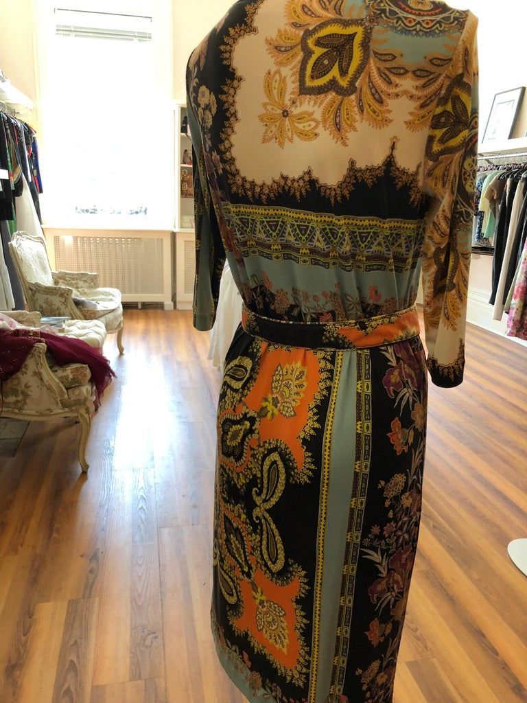 Mixed paisley and floral pattern in brilliant colors, this dress can be worn on its own or with the belt provided. Suitable as a day or cocktail dress.