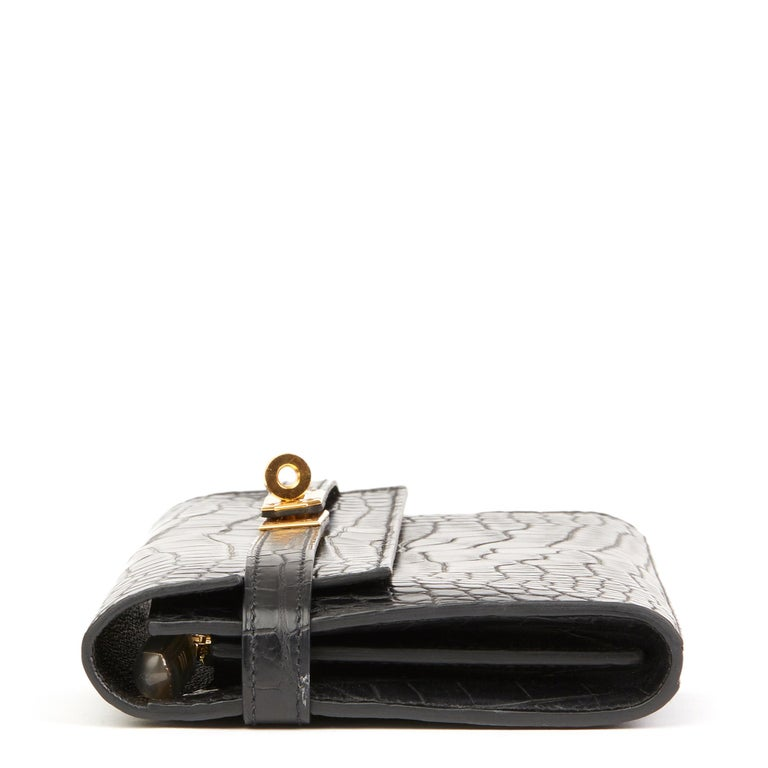 HERMÈS Black Matte Mississippiensis Alligator Leather Kelly Long Wallet  Xupes Reference: HB2544 Serial Number: A Age (Circa): 2017 Accompanied By: Hermès Box, Protective Felt Authenticity Details: Date Stamp (Made in France) Gender: Ladies Type: