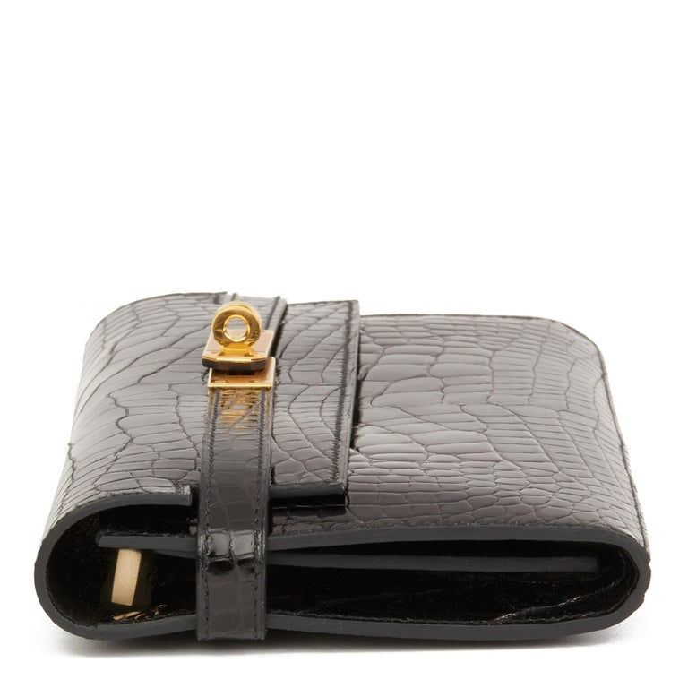 HERMÈS Black Shiny Mississippiensis Alligator Leather Kelly Long Wallet  Reference: HB2597 Serial Number: A Age (Circa): 2017 Accompanied By: Hermès Dust Bag, Protective Felt Authenticity Details: Date Stamp (Made in France) - 'X' stamp in the