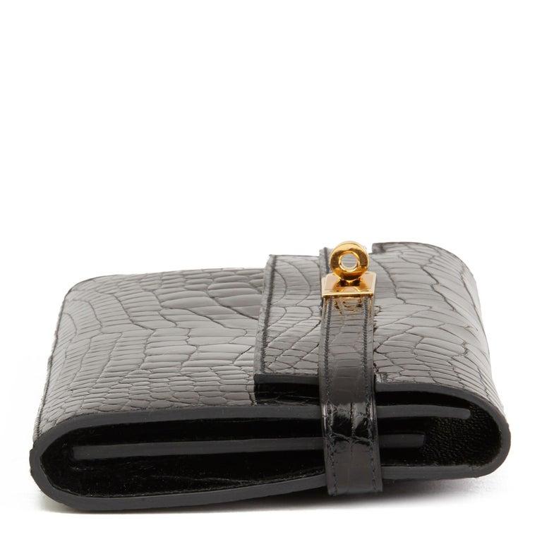 2017 Hermès Black Shiny Mississippiensis Alligator Leather Kelly Long Wallet  In Excellent Condition For Sale In Bishop's Stortford, Hertfordshire
