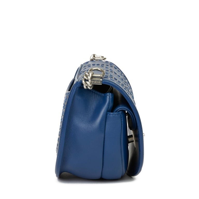 CHANEL Blue Quilted Calfskin Coco Eyelets Round Flap Bag  Xupes Reference: HB3395 Serial Number: 25059099 Age (Circa): 2018 Accompanied By: Chanel Dust Bag, Authenticity Card Authenticity Details: Authenticity Card, Serial Sticker (Made in Italy)