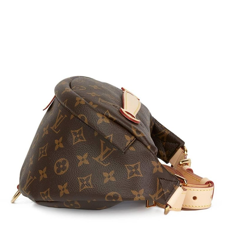 df3f53be2c4 LOUIS VUITTON Brown Monogram Coated Canvas Bumbag This LOUIS VUITTON Bumbag  is in Unworn Condition accompanied