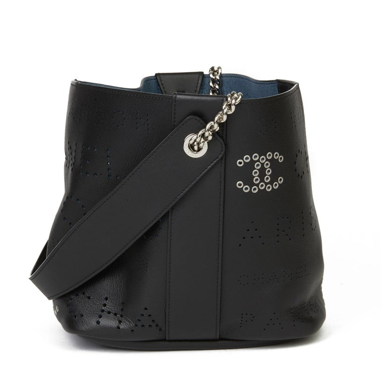 CHANEL Black Perforated Calfskin Leather Logo Eyelets Bucket Bag with Tweed Pouch  Xupes Reference: HB3634 Serial Number: 27142896 Age (Circa): 2019 Accompanied By: Authenticity Card, Pouch Authenticity Details: Authenticity Card, Serial Sticker