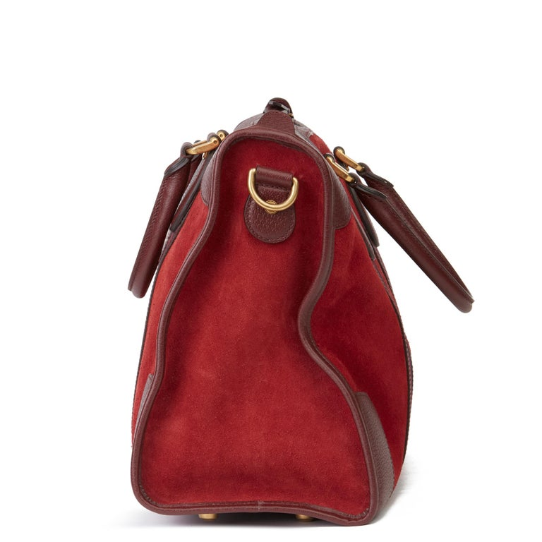 GUCCI Red Suede & Burgundy Pigskin Web Medium Duffle Bag  Xupes Reference: HB3226 Serial Number: 459311 467891 Age (Circa): 2019 Accompanied By: Gucci Dust Bag, Care Booklet, Leather Swatch, Shoulder Strap Authenticity Details: Serial Stamp (Made in