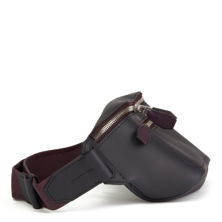 HERMÈS Indigo & Raisin Cristobal, Veau Doblure Leather Cityslide Cross PM  Xupes Reference: CB161 Serial Number: D Age (Circa): 2019 Accompanied By: Hermes Dust Bag, Box, Copy of Hermes Invoice Authenticity Details: Date Stamp (Made in