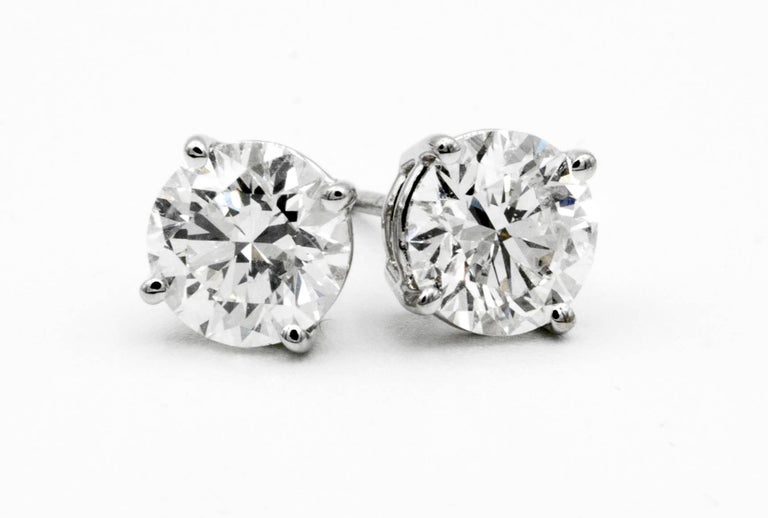 2.02 Carat Diamond Stud earrings in 14K White Gold A pair of Diamond stud earrings weighing 2.02 Carats total.  Color is H , Clarity is SI2 6.4 MM Diameter, beautifully cut and perfectly matched pair