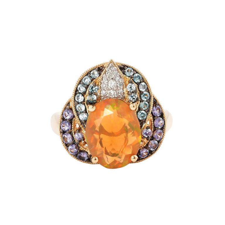 Oval Cut 2.02 Carat Ethiopian Opal Ring in 14 Karat Yellow Gold with Diamonds For Sale