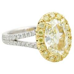 2.02 Carat Oval Fancy Light Yellow Diamond Ring