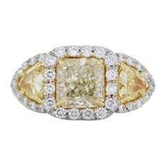 2.02 Carat Radiant Cut Fancy Light Yellow Diamond Ring in Platinum