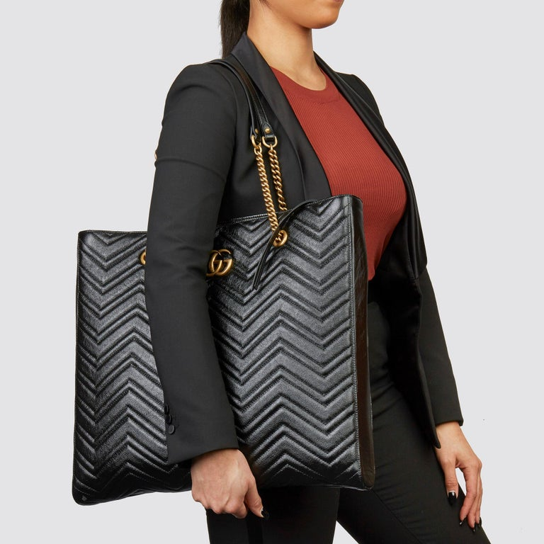 GUCCI Black Quilted Shiny Calfskin Leather Marmont Shoulder Tote  Xupes Reference: HB3603 Serial Number: 524576 493075 Age (Circa): 2020 Accompanied By: Gucci Dust Bag Authenticity Details: Date Stamp (Made in Italy) Gender: Ladies Type: Tote,