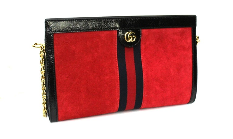 Gucci Ophidia line bag made of red suede with black leather details, web band decoration and golden hardware. Magnetic flap closure, internally large enough. Equipped with removable chain shoulder strap. The bag is in mint condition.