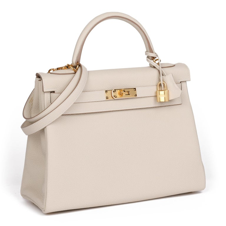 HERMES Craie Togo Leather Kelly 32cm Retourne  Xupes Reference: CB376 Serial Number: Y Age (Circa): 2020 Accompanied By: Hermès Dust Bag, Box, Protective Felt, Lock, Keys, Clochette, Rain Cover, Shoulder Strap  Authenticity Details: Date Stamp (Made