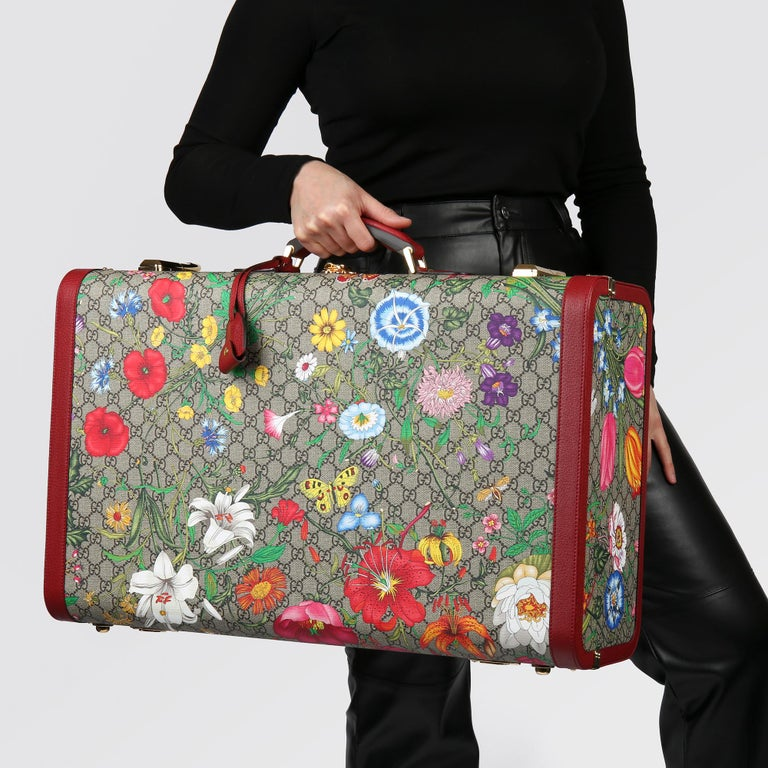 GUCCI GG Flora Coated Canvas & Red Pigskin Leather Large Suitcase Trunk   Xupes Reference: HB3769 Serial Number: 602675 618120  Age (Circa): 2021 Accompanied By: Clochette, Keys, Care Booklet Authenticity Details: Date Stamp (Made in Italy)  Gender: