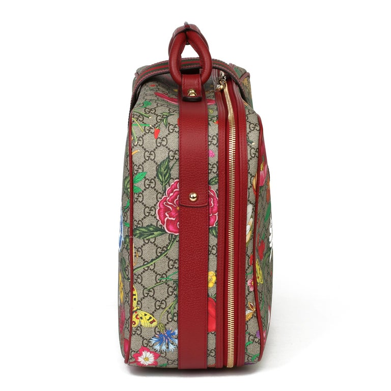 GUCCI GG Flora Coated Canvas & Red Pigskin Leather Suitcase   Xupes Reference: CB262 Serial Number: 424501.0011998 Age (Circa): 2021 Accompanied By: Gucci Dust Bag, Care Booklet, Padlock, Keys, Clochette, Luggage Tag Authenticity Details: Date Stamp