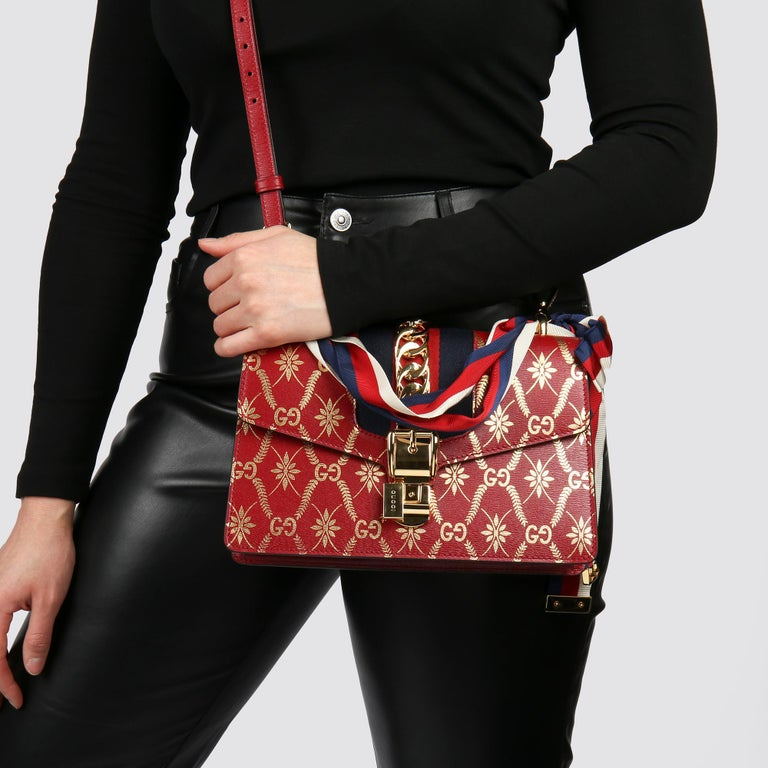 GUCCI Red & Gold Calfskin Leather Top Handle Small Sylvie   Xupes Reference: HB3766 Serial Number: 524401 493075 Age (Circa): 2021 Accompanied By: Gucci Dust Bag, Shoulder Strap Authenticity Details: Date Stamp (Made in Italy)  Gender: Ladies Type:
