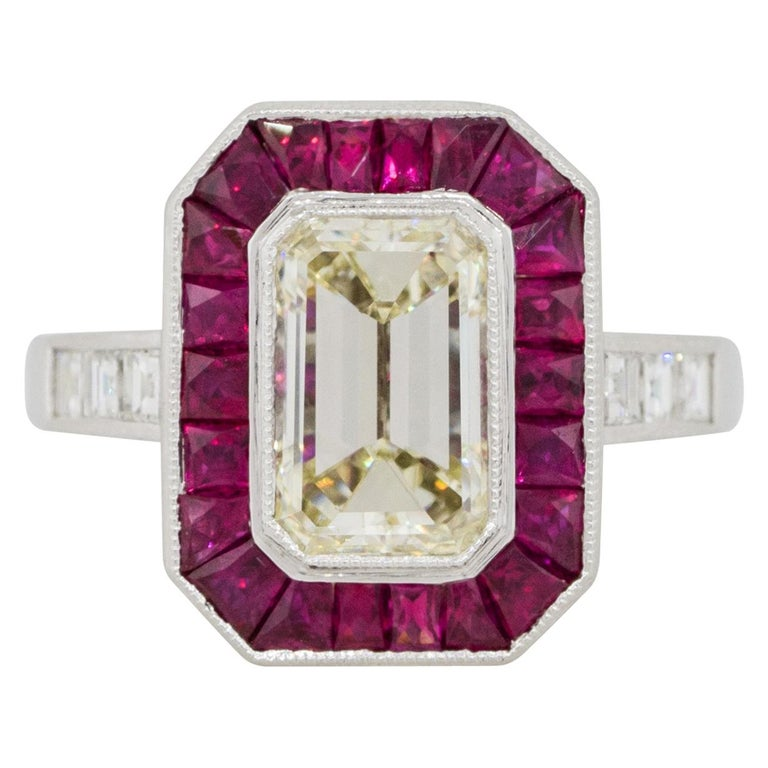 2.03 Carat Emerald Cut Diamond Center Ring with Rubies Platinum in Stock For Sale