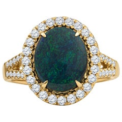 2.04 Carat Australian Opal with 0.54 Carat in Diamonds set in 18 Karat Gold Ring