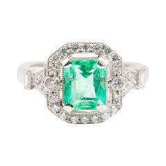 2.04 Carat Green Emerald Cut Emerald and 0.42 Carat Diamond Halo Platinum Ring