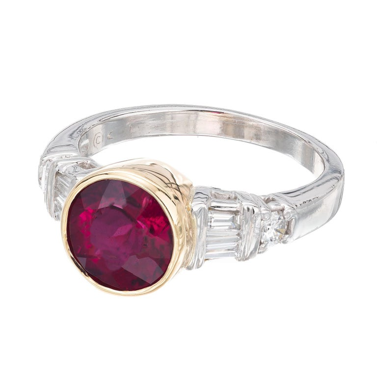Mid-Century red Tourmaline Rubelite and diamond engagement ring. AGL certified 2.04ct purple/red round center tourmaline accented with 6 tapered baguettes and 2 round diamonds a platinum and 18k yellow gold setting bezel setting.   1 round purplish