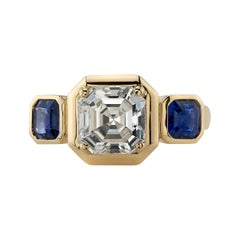 2.05 Carat Asscher Cut Diamond Set in a Handcrafted Three Stone Yellow Gold Ring