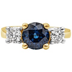 2.05 Carat Blue Sapphire and Diamond Three-Stone Engagement Ring