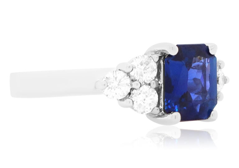 Material: 18k White Gold  Center Stone Details:  1 Radiant Cut Blue Sapphire at 2.05 Carats - Measuring 8 x 6.8 mm Diamond Details: 6 Brilliant Round White Diamonds at Approximately 0.70 Carats - Clarity: SI / Color: H-I Alberto offers complimentary