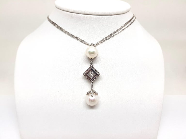 Gold: 18 carat white gold  Weight: 14.53gr.  Diamonds: 2.06 ct. colour: F clarity: VS1  Pearls: 2 Akoya pearls of 11mm each  Length Pendant: 5.5cm  Width Pendant: 1.6cm  Length Chain: 42.0cm.  All our jewellery comes with a certificate and 5 years