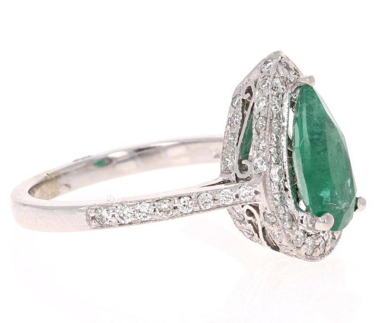 Modern 2.07 Carat Emerald Diamond Halo Gold Ring For Sale