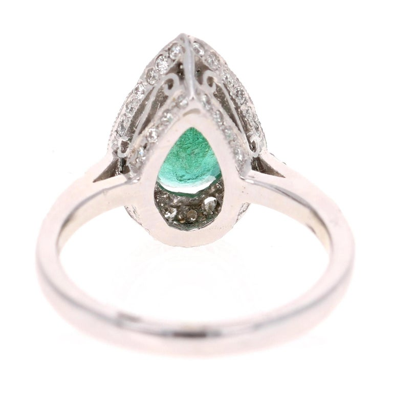 Pear Cut 2.07 Carat Emerald Diamond Halo Gold Ring For Sale