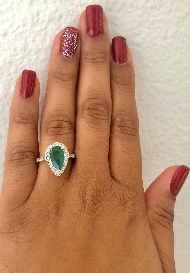 Women's 2.07 Carat Emerald Diamond Halo Gold Ring For Sale