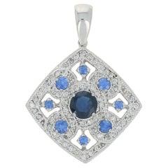 2.07 Carat Round Brilliant Sapphire, Diamond Pendant, 14 Karat Gold Floral Halo