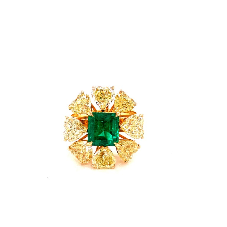 2.08 carat GRS Certified Vivid Green Colombian Emerald and Yellow Diamond Engagement Ring:  A beautiful ring, it features a rare vivid green Colombian emerald weighing 2.08 carat, accompanied by a GRS Lab certificate, along with a halo of intense