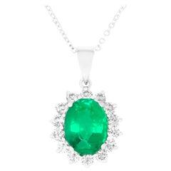 Oval Cut Emerald Surrounding Round White Diamond Pendant 14K White Gold