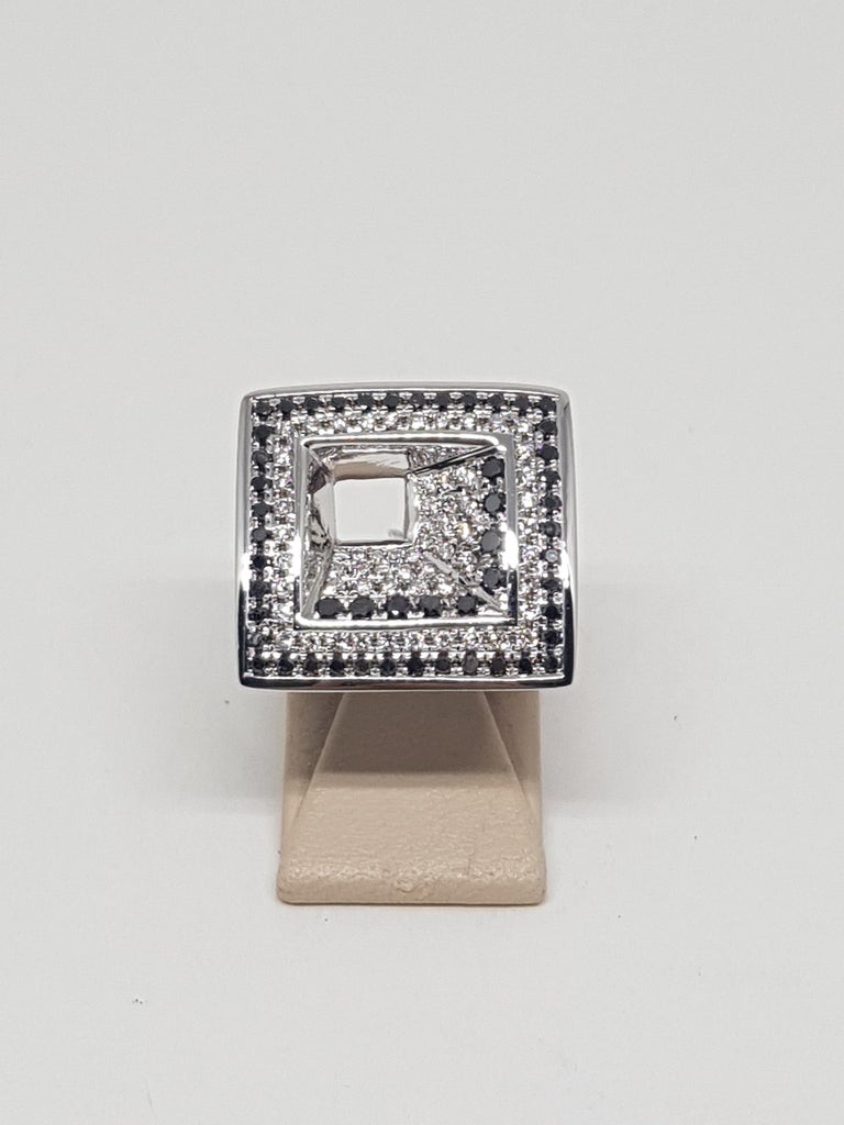 Gold: 18 carat white gold  Weight: 16,18gr. White Diamonds: 1,24 ct. colour: F clarity: VS ( 77 Diamonds ) Black Diamonds: 0,84 ( 53 Diamonds ) Width: 2,0 cm. Ring size: 57 / 18,2mm Free Resizing All our jewellery comes with a certificate and 5
