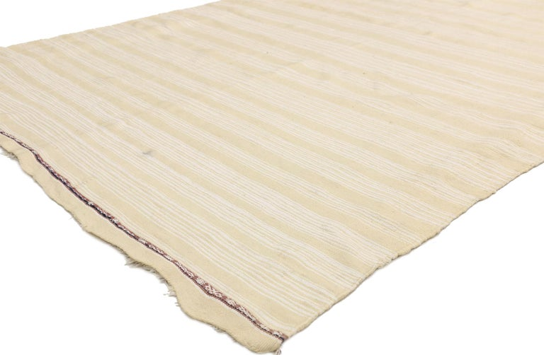 20815, Vintage Moroccan Handira Kilim, Neutral Flat-weave Rug. This neutral flat-weave Kilim rug emanates function and versatility with relaxed hygge vibes. This handwoven wool vintage Moroccan Kilim rug features rows of creamy-vanilla bands and