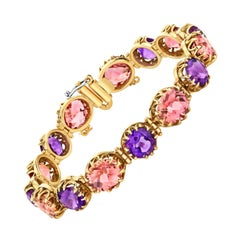 20.83 Carat Total Pink Tourmaline and Amethyst Yellow Gold Tennis Bracelet