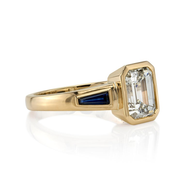2.09ctw U-V/VS1 GIA certified Emerald cut diamond with 0.73ctw Baguette cut blue sapphire accents set in a handcrafted 18K yellow gold mounting.  Ring is currently a size 6 and can be sized to fit.
