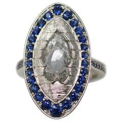 2.09 Carat Fancy Shape White Rose Cut Diamond and Blue Sapphire Engagement Ring.
