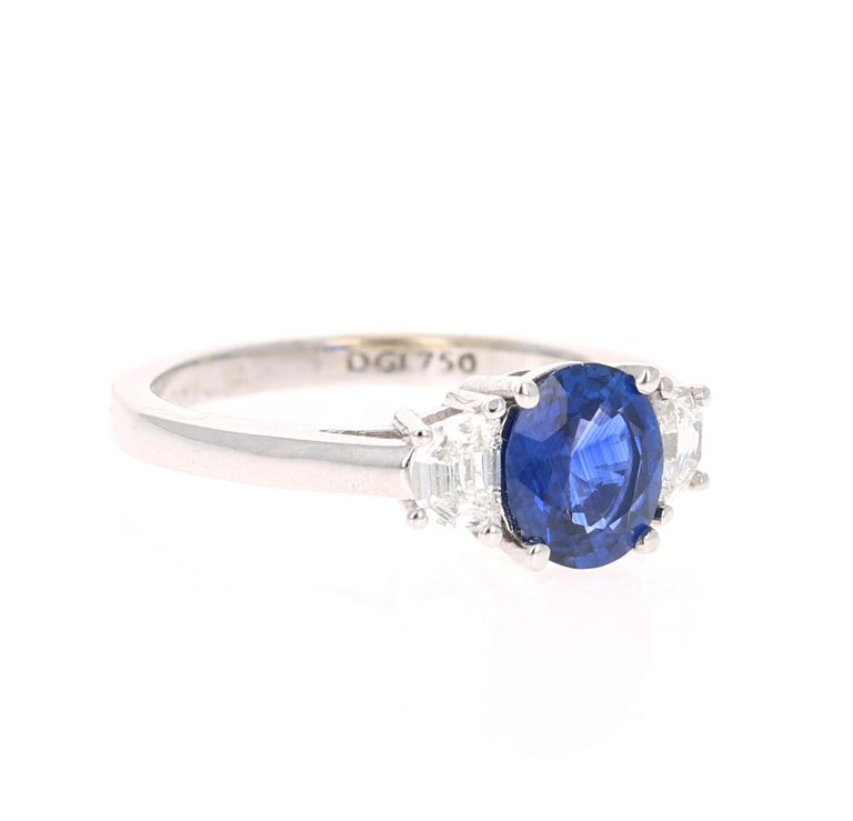 Beautiful Sapphire Diamond Three-Stone Engagement Ring  This ring has a Blue Sapphire that weighs 1.55 Carats and is GIA Certified. The Sapphire is a natural Blue Oval Cut with Heat. The GIA Certificate Number is: 6192734246. The Sapphire measures