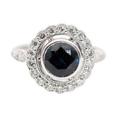 2.09 Carat Natural Round Blue Sapphire and Diamond 18 Carat Halo Vintage Ring