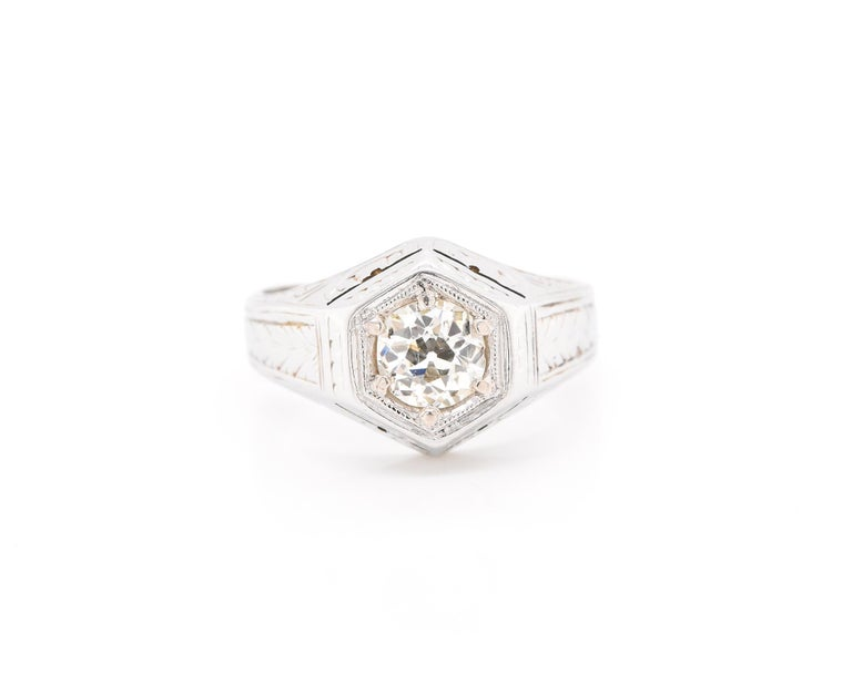 Designer: custom Material: 20k white gold Diamond: 1 euro round cut = 0.75ct Color: J Clarity: SI2 Size: 6  (please allow two additional shipping days for sizing requests)   Dimensions: ring measures 12.05mm in width Weight: 5.40 grams